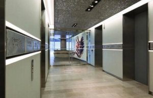 The foyer leading into the offices of Hudbay Minerals Inc. Solid zinc ingots provided by HudBay, mounted flush into wall and custom metal ceiling of recycled aluminum, illuminated from above